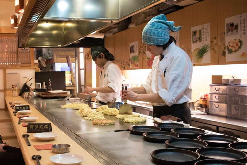 When visiting Japan, one of the tasty local Japanese foods is okonomiyaki, a savory pancake.