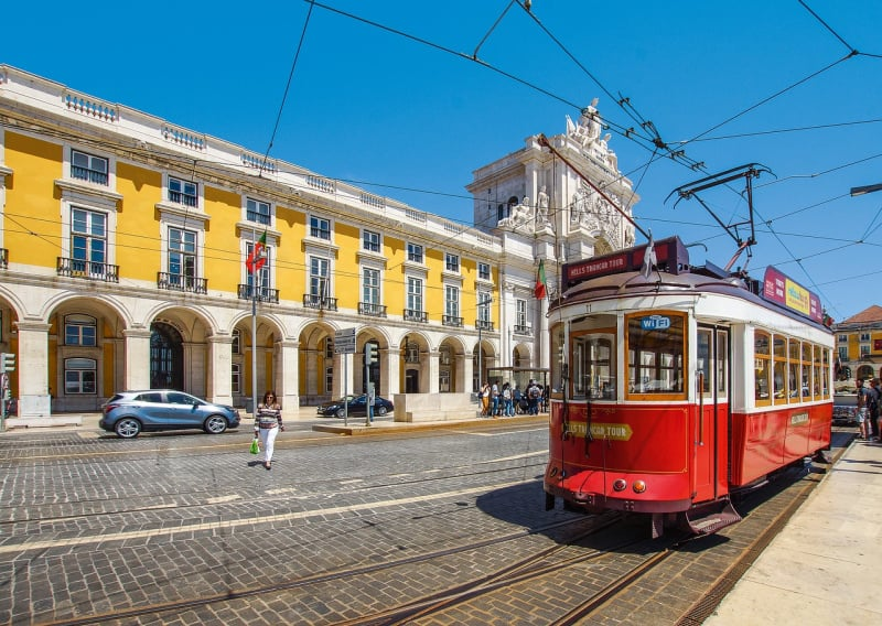 Avoid accidents by opting for train travel, like this tram in Lisbon, Portugal, instead of driving rental cars.