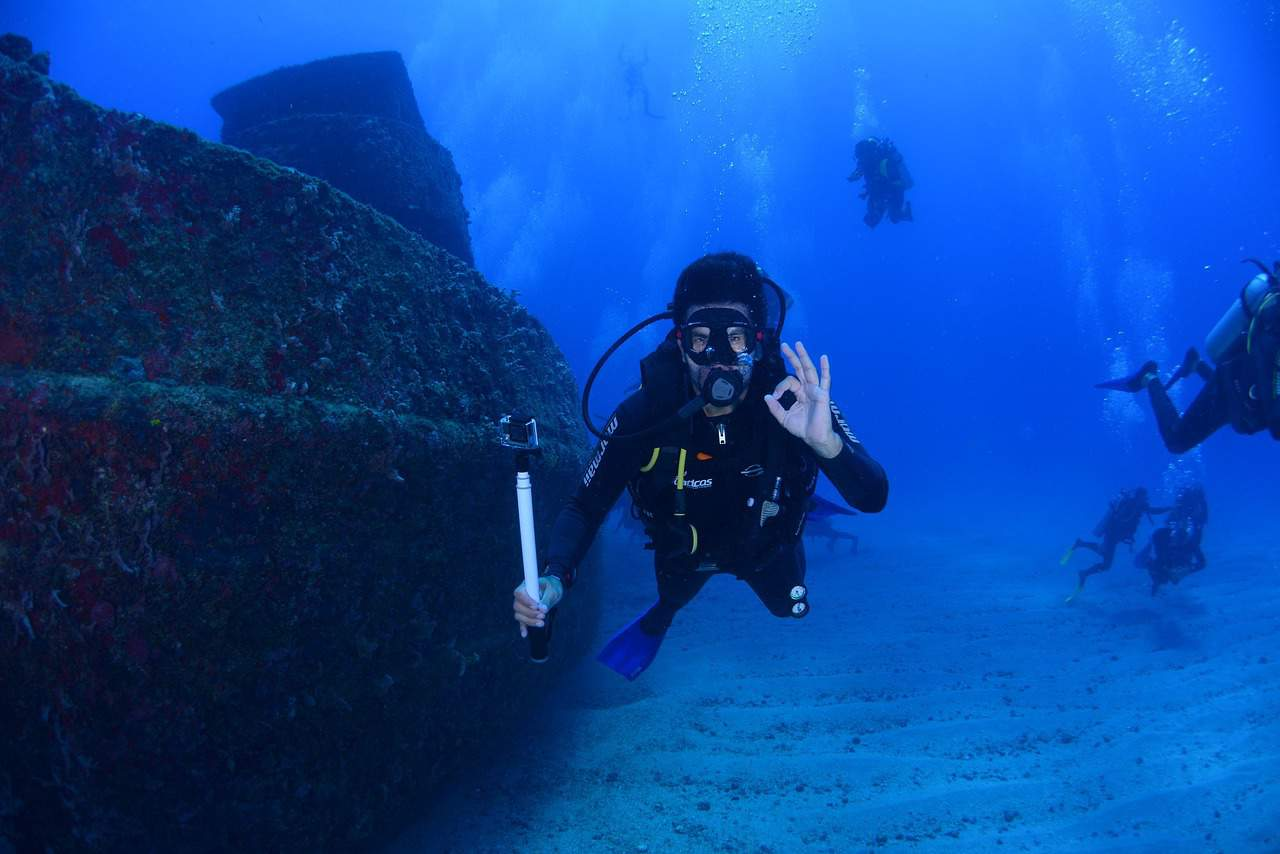 For your safety and others, learn the essential scuba diving signals.